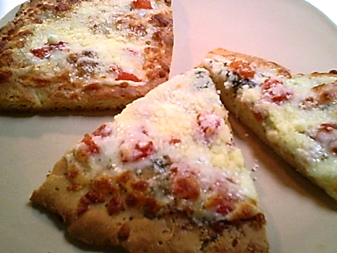 King Arthur Flour Gluten-Free Pizza Bread Mix Baked and Topped with Mozzarella, Chopped Tomato, Garlic, Basil and Parmesan