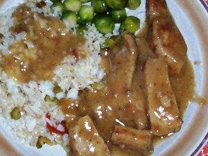Gluten-Free Pork Rib Chops with Gravy, Served with Brussels Sprouts and Rice with Onion and Peppers