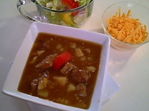 Gluten-Free Carne Guisada with Salad and Shredded Cheese
