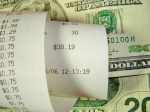 grocery shopping money and cash register receipt
