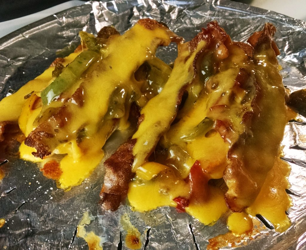 Gluten-Free Broiled Chicken Breasts Under a Raft of Pepper & Onions, Bacon and Drenched with Melted Sharp Cheddar