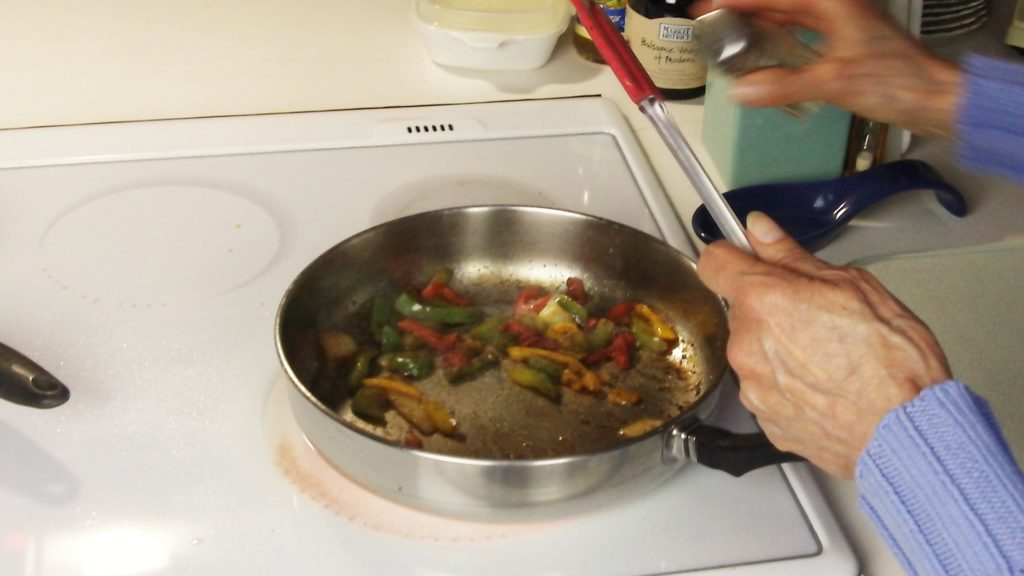 Seasoning to Taste - Peppers & Onions Being Sauteed in 1 Tbsp of Bacon Drippings